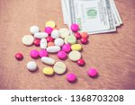 many color of pills and dollars ... | Shutterstock . vector #1368703208