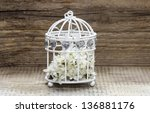 Birdcage With Flowers Inside O...