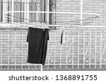hanging clothes on the clothes... | Shutterstock . vector #1368891755