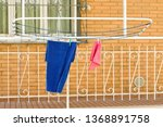hanging clothes on the clothes... | Shutterstock . vector #1368891758