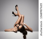 woman sexy legs in black shoes. ... | Shutterstock . vector #1368987635