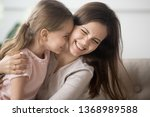 laughing mother or older sister ... | Shutterstock . vector #1368989588
