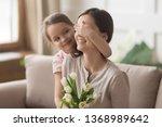 loving daughter closing mum... | Shutterstock . vector #1368989642
