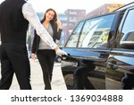 Chauffeur Opening Private Car...