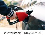 man's hand is refuelling gas or ... | Shutterstock . vector #1369037408