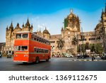 Small photo of Mumbai, India - Old bus in front of In front of Chhatrapati Shivaji Terminus (formerly Victoria Terminus) a historic railway station and a UNESCO World Heritage Site in the city center