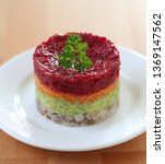 Stock photo herring appetizer with beetroot carrot and avocado 1369147562