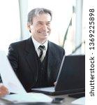 smiling senior businessman... | Shutterstock . vector #1369225898