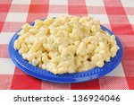 A Plate Of Macaroni Salad On A...