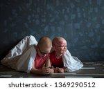 caucasian children in pink t... | Shutterstock . vector #1369290512