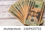 Small photo of Stack of used twenty dollar bills on wooden background