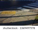 a cross walk with yellow... | Shutterstock . vector #1369497578
