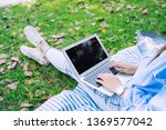 closeup of people using laptop... | Shutterstock . vector #1369577042