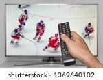 hockey match on tv and human... | Shutterstock . vector #1369640102