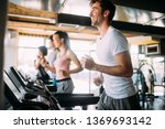 happy fit people running on... | Shutterstock . vector #1369693142