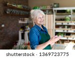 shop assistant with digital... | Shutterstock . vector #1369723775