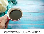 woman hand holding a cup of... | Shutterstock . vector #1369728845