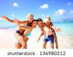 family of four having fun at... | Shutterstock . vector #136980212