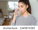 beautiful young woman drinking... | Shutterstock . vector #1369874285