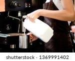young woman barista wearing... | Shutterstock . vector #1369991402