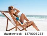 Smiling Woman Sunbathing On...