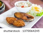 Stock photo fried king mackerel fish served with sweet and sour spicy sauce 1370064245