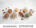various nuts in  bowls on white ... | Shutterstock . vector #1370109158