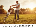 happy young father plauing with ... | Shutterstock . vector #1370115512