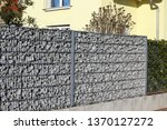 gabion fence wall | Shutterstock . vector #1370127272