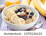 tasty oatmeal porridge bowl... | Shutterstock . vector #1370136122