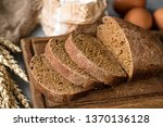 rye bread sliced on wooden... | Shutterstock . vector #1370136128
