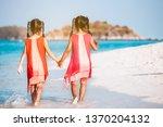 two cute asian child girls... | Shutterstock . vector #1370204132