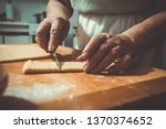 making and baking traditional... | Shutterstock . vector #1370374652