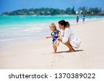 mother and child playing at... | Shutterstock . vector #1370389022