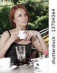 young girl in open air cafe | Shutterstock . vector #13704364