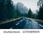 road in the spring forest in... | Shutterstock . vector #1370489045