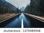 road in the autumn forest in... | Shutterstock . vector #1370489048