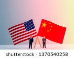 Small photo of 2 Miniature figure with USA and China flags. Its is symbol for tariff trade war crisis or unfair business of 2 biggest economic countries in the world.