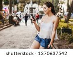 young latin woman messaging by... | Shutterstock . vector #1370637542