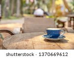 a coffee cup  on wood table... | Shutterstock . vector #1370669612