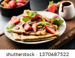 french crepes with strawberries ... | Shutterstock . vector #1370687522