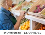 shop assistant with digital... | Shutterstock . vector #1370790782