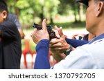 trainer training gun shooting...   Shutterstock . vector #1370792705