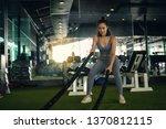 woman with battle rope battle... | Shutterstock . vector #1370812115