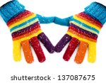Colored Gloves On White Snow