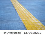 bright yellow tactile paving... | Shutterstock . vector #1370968232