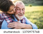 a small girl with grandfather... | Shutterstock . vector #1370975768