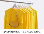 fashionable clothing on hangers ... | Shutterstock . vector #1371034298