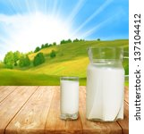 pitcher of milk on table | Shutterstock . vector #137104412