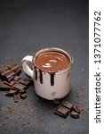 cup of hot chocolate and pieces ...   Shutterstock . vector #1371077762